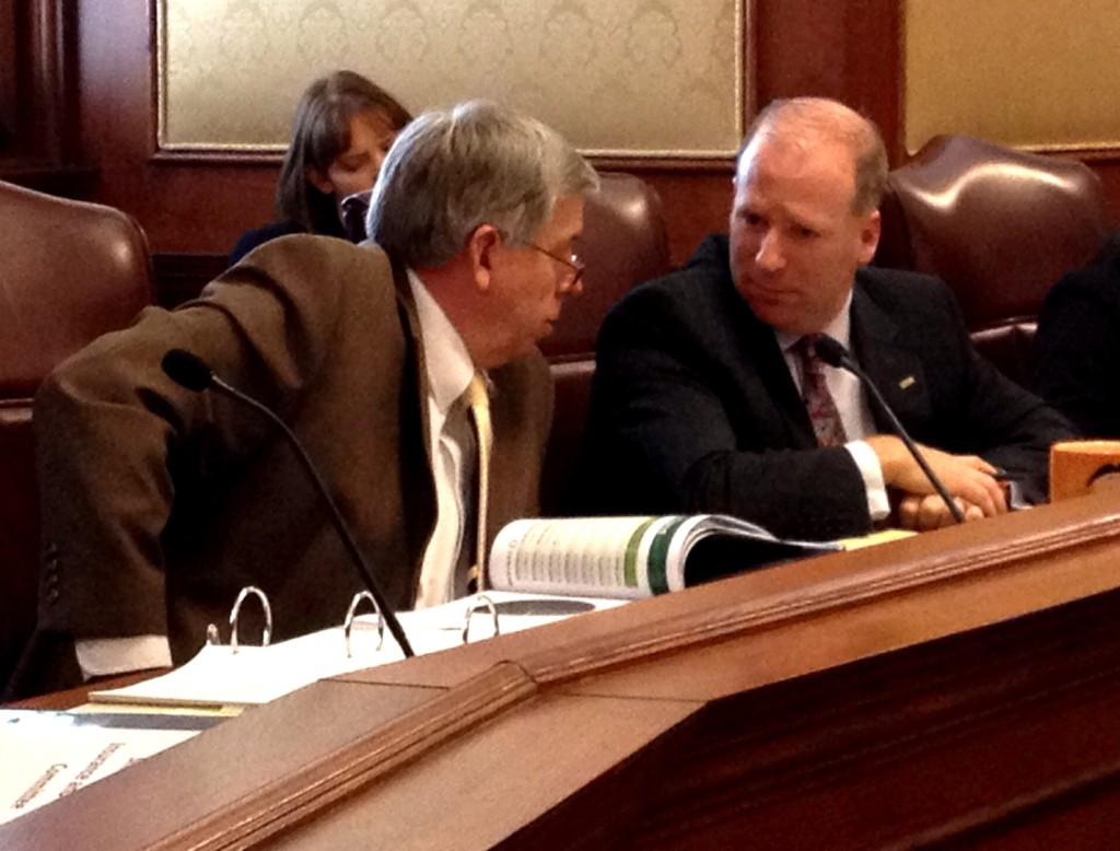 Sen. Rupp (right) discusses his bill with Sen. Parson during a Senate Small Business Committee hearing.