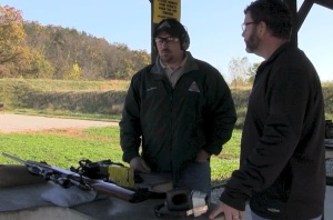 Kyle Lairmore (L) of the Missouri Department of Conservation shows Bill Pollock some tips on sighting in a rifle (Photo/Karen Hudson)