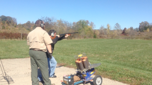 Bill Pollock prepares for his waterfowl hunt by practicing with his firearm on the skeet range
