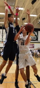 Father Tolton and Helias Catholic battle Tuesday night at Rackers Fieldhouse (photo/Twitter@CrusaderRaid)